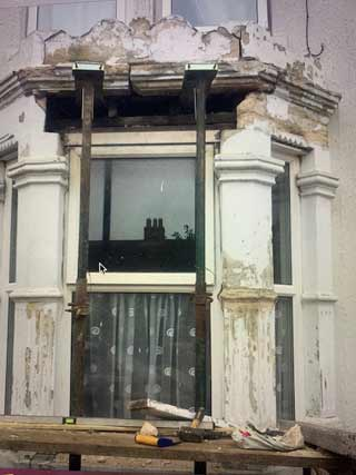damaged window and surround